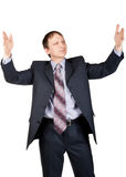Handsome businessman holding  something invisible Royalty Free Stock Photography