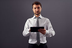 Handsome businessman holding tablet pc Stock Photos