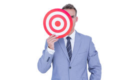 Handsome businessman holding target Stock Photo