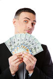 Handsome businessman holding US dollars Royalty Free Stock Photography
