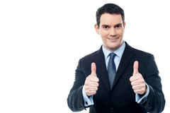 Handsome businessman holds his thumbs up Stock Photography