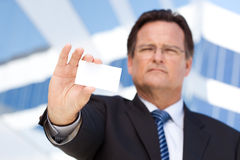 Handsome Businessman Holds Out Blank Business Card Royalty Free Stock Photos
