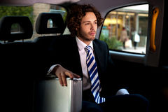 Handsome businessman inside taxi cab Stock Photo