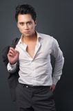 Handsome Businessman with Jacket over his Shoulder Royalty Free Stock Photography