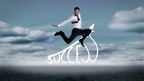 Handsome businessman jumping in front of success graphic Stock Images