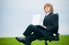 Handsome businessman with laptop Royalty Free Stock Photo