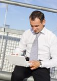 Handsome businessman with laptop computer Stock Photo