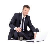 Handsome businessman with laptop isolated on white background Royalty Free Stock Photo