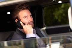 Handsome businessman in limousine stock images