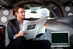 Handsome businessman in limousine stock photography