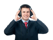 Handsome businessman listening to music Stock Image