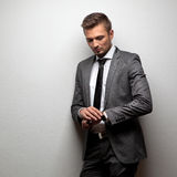 Handsome businessman look his watch on white royalty free stock photography