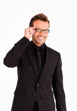 Handsome businessman looking at the camera Royalty Free Stock Images