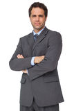 Handsome businessman looking at camera with arms crossed Royalty Free Stock Photo