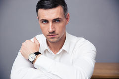 Handsome businessman looking at camera Stock Images