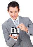 Handsome businessman looking cards Royalty Free Stock Image