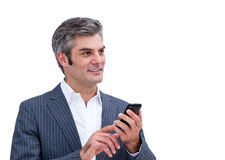Handsome businessman looking at his phone Royalty Free Stock Images