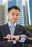 Handsome businessman looking at his watch Royalty Free Stock Photography