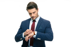 Handsome businessman looking on his wrist watch Royalty Free Stock Photos