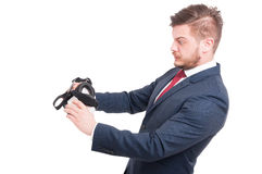 Handsome businessman looking scared Stock Images