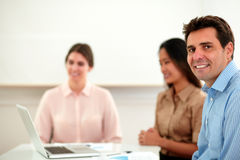 Handsome businessman looking and smiling at you Stock Photography