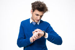 Handsome businessman looking at watch. Over white background Stock Photos