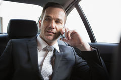 Handsome businessman making a phone call Stock Photography