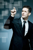 Handsome businessman making pointing gesture. Stock Images