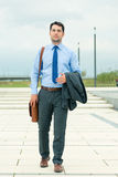 Handsome businessman or manager going home Royalty Free Stock Photo