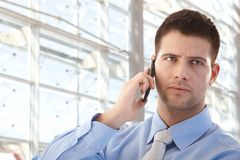 Handsome businessman on mobile Stock Photo