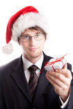 Handsome businessman offering a christmas gift Royalty Free Stock Images