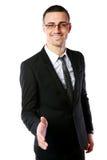 Handsome businessman offering handshake Stock Image