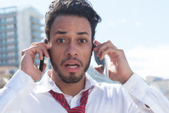 Handsome Businessman On Two Phones Royalty Free Stock Image