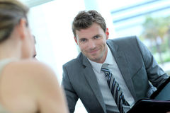Handsome businessman with partner royalty free stock images