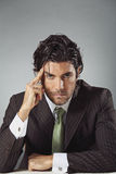 Handsome businessman with pensive expression Stock Images