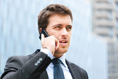 Handsome businessman at phone Royalty Free Stock Photos