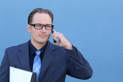 Handsome businessman on the phone Stock Images