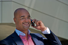 Handsome businessman with phone Stock Photography