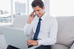 Handsome businessman on the phone. At the office Stock Photos