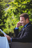 Handsome businessman on the phone and reading the menu Royalty Free Stock Image
