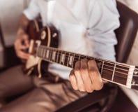 Handsome businessman playing guitar Stock Photos