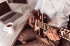 Handsome businessman playing guitar Stock Image