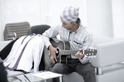 Handsome businessman playing the guitar in office Royalty Free Stock Images