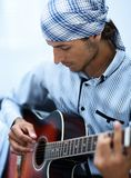 Handsome businessman playing the guitar in office Stock Photo