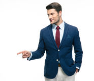 Handsome businessman pointing finger away Stock Photos