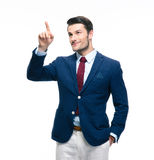 Handsome businessman pointing finger up Stock Photography