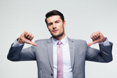 Handsome businessman pointing at herself Stock Photo