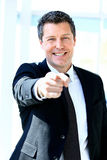 Handsome businessman pointing Stock Photography