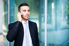 Handsome businessman portrait talking at the phone Stock Photo