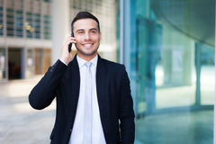 Handsome businessman portrait talking at the phone Royalty Free Stock Photo